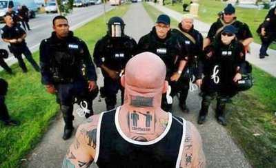 demonstration picture big guy vs cops